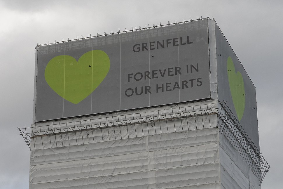 Close-up of Grenfell Tower with banners in June 2018