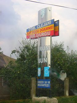 Welcome sign at the commune entry