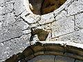 Conne-de-Labarde église portail tête.JPG