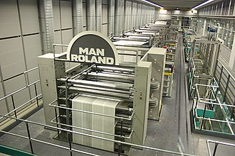Offset printing - Web-fed offset lithographic press at speed.