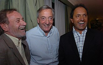 Daniel Scioli - Scioli's running mate, Alberto Balestrini, President Kirchner and Scioli celebrate the victory of the Scioli-Balestrini ticket in the 2007 race for the Governor of the Province of Buenos Aires, the nation's largest.