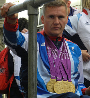 David Weir (wheelchair athlete) - Weir at the Olympics Victory Parade wearing the four gold medals he won during the 2012 Summer Paralympics
