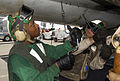 Defense.gov News Photo 100510-N-9537D-001 - U.S. Navy Petty Officer 3rd Class Edward Effinger and Airman Christopher Estes perform routine maintenance on an F A-18C Hornet aircraft aboard the.jpg
