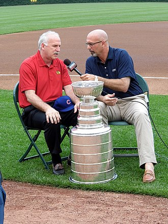 Jim Deshaies - Deshaies interviewing Blackhawks coach Joel Quenneville before a pregame celebration for the 2013 Stanley Cup champion Blackhawks at Wrigley Field