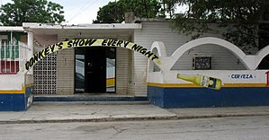 "Donkey show - A bar in Boy's Town, Nuevo Laredo, Mexico advertising a nightly ""donkey's show"""