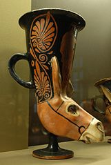 plastic rhyton in the shape of a donkey's head representing Dionysos and a maenad