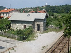 Draga, railway halt. In the background, Prophet Daniel Parish Church in Dornberk.