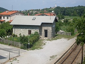 Draga, Nova Gorica - Draga, railway halt. In the background, Prophet Daniel Parish Church in Dornberk.