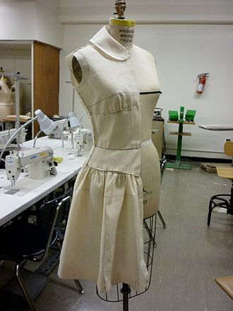 Costume design - Example of draping muslin fabric onto a dress form