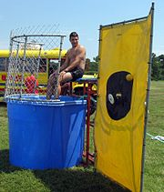 The dunking mechanism on the typical dunk tank is triggered by a ball hitting a small target.