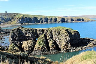 Dunnicaer Sea stack and remains of Pictish hill fort in Aberdeenshire, Scotland