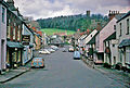 Dunster High Street and view to the Yarn Market and Castle, 1963 geograph-3292405-by-Ben-Brooksbank.jpg