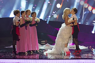 Eurovision Song Contest 2013 - Finland's contestant Krista Siegfrids kissing one of her backing singers.