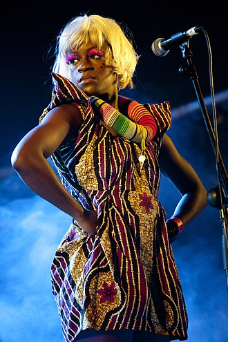 Backing vocalist - One of the Wives, the backing vocalists for English singer Ebony Bones