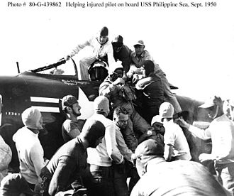 USS Philippine Sea (CV-47) - Ensign Jackson being helped from Grumman F9F-2 Panther after landing blind.