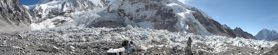 A view of Everest southeast ridge base camp. The Khumbu Icefall can be seen on the left. In the centre are the remnants of a helicopter that crashed in 2003.