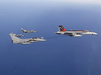 Carrier-based aircraft - A French Navy Rafale M refuels from a U.S. Navy F/A-18E Super Hornet, accompanied by two French Super Étendards.