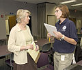 FEMA - 31628 - FEMA Public Informaton Officer talks with Minnesota Liaison.jpg