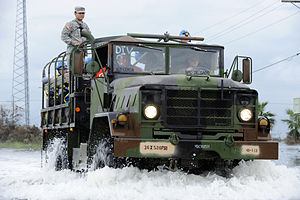 FEMA - 38981 - FEMA USAR team riding into the impact zone on a military truck in Texas.jpg