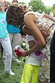First lady Michelle Obama hugs a child during a Memorial Day ceremony in Section 60 at Arlington National Cemetery in Arlington, Va., May 27, 2013 130527-A-VS818-529.jpg