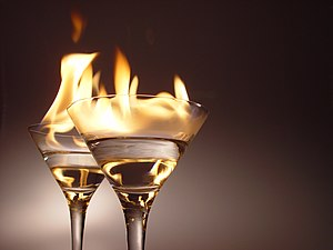 Alcoholic drink - These flaming cocktails illustrate that high-proof alcohol will readily catch fire and burn.