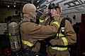 Flickr - Official U.S. Navy Imagery - A Sailor don his fire fighting equipment..jpg