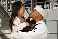 Flickr - Official U.S. Navy Imagery - A Sailor receives the first hug from his daughter during a homecoming celebration..jpg