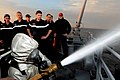 Flickr - Official U.S. Navy Imagery - Sailors observe a French sailor demonstrating fire fighting techniques during the French sailors' visit..jpg