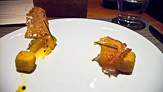 Molecular gastronomy - A molecular gastronomy rendition of eggs Benedict served by wd~50 in New York City. The cubes are deep-fried Hollandaise sauce.