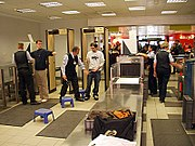 Baggage is scanned using X-ray machines, passengers walk through metal detectors