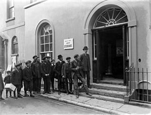 Male unemployment - Unemployed men queuing for work at a labour exchange.