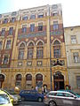 Former HQ of the Metropolitan Shoemakers Guild. Monument ID 11573. Entrance. Colorful mosaic images with the year of construction. At the banquet hall level, some neo-Gothic windows.- Budapest.JPG