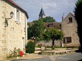 The fountain in Frémainville, with the church in the background
