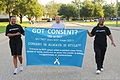 "From left, U.S. Air Force Capt. Chandra Sawyer, Capt. Kevin Johnson and LaNesa Howard carry a banner explaining the ""Got Consent?"" campaign July 29, 2011, during the warrior run on Maxwell Air Force Base, Ala 110729-F-LK593-047.jpg"