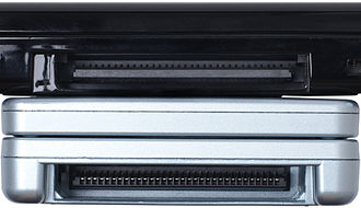 Nintendo DS - Game Boy Advance game slot on Game Boy Advance SP (below) and Nintendo DS Lite (above).