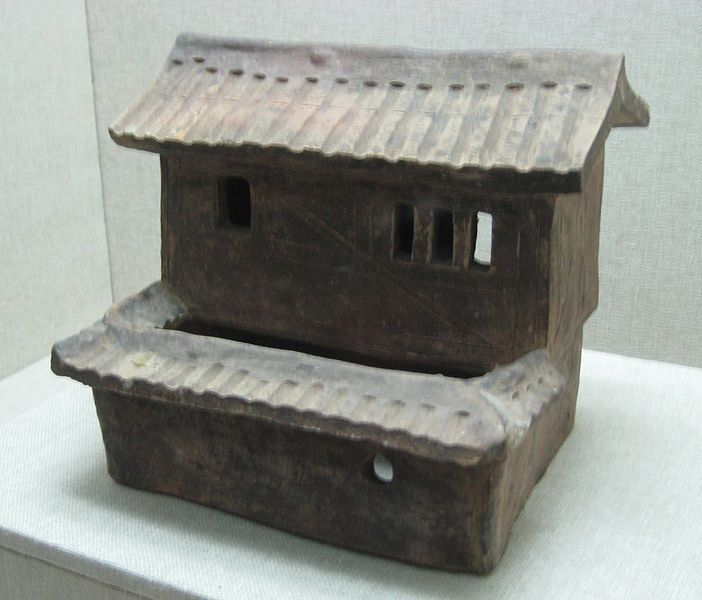 File:Glazed pottery stilt house with carved design.jpg