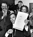 """Governor Robert """"Bob"""" Martinez signing Dr. Martin Luther King Jr. holiday measure into law in Tallahassee, Florida.jpg"""