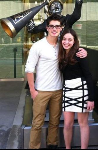Gregg Sulkin - Sulkin posing with a fan in January 2012