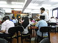 HK Sai Ying Pun Lin Heung Kui restaurant interior waiter n visitors Aug-2012.JPG