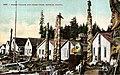 Haida boys near totem poles, canoes and houses at Howkan village, Long Island, Alaska, circa 1897 (AL+CA 1332).jpg