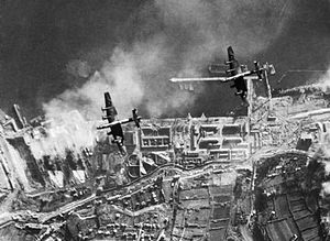 No. 35 Squadron RAF - 35 Squadron Halifaxes attacking German battleships Scharnhorst and Gneisenau in drydock at Brest, France, December 1941