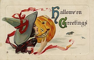 """Halloween card - An early 1900s Halloween post card depicting a woman dressed as a witch with a Jack-o'-lantern, captioned as """"Hallowe'en Greetings"""""""