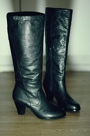 Fashion boot - A pair of women's heeled knee-high boots
