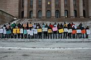 People express solidarity in front of Finnish Parliament building, Helsinki, Finland.
