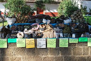 English: Street vendor selling herbal remedies...