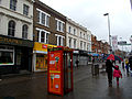 High St in the rain, SUTTON, Surrey, Greater London.jpg