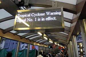 Hong Kong tropical cyclone warning signals - Typhoon warning signal 1 shown at the Mid-Level escalators