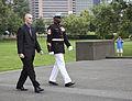 Honorary Marine Daran Wankum, left, walks alongside a Marine 1st sergeant during a wreath laying ceremony at the Marine Corps War Memorial in Arlington, Va, June 13, 2013 130613-M-KS211-003.jpg