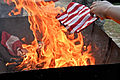 Honoring a symbol, Team Seymour holds flag retiring ceremony 140614-F-OB680-109.jpg