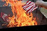 Honoring a symbol, Team Seymour holds flag retiring ceremony 140614-F-OB680-109.jpg
